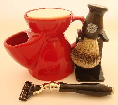 Red Pottery shaving mug, Mannin E black mach 3 razor, shaving brush and dripstand